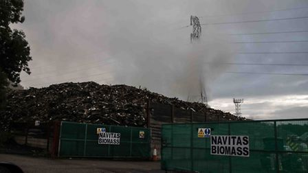 Smoke pours out from the wood waste site in Potters Crouch, where yet another fire has broken out. P