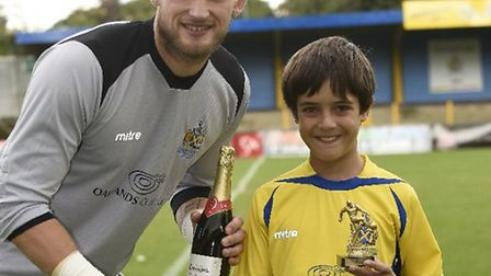 Joe Welch picks up his player of the month award for August