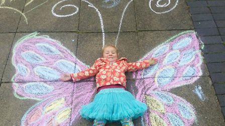 One girl's chalk butterfly on the pavement.
