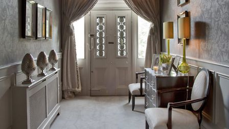 Make a dramatic entrance with a curtain track at your front door that's elegant and good for keeping