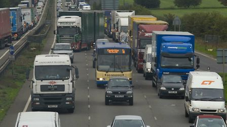 There are lengthy tailbacks on A14 spur road following an incident
