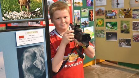 Godmanchester Show, at St Marys Church, Danny Kember, (15) who won a first place with his elephant p