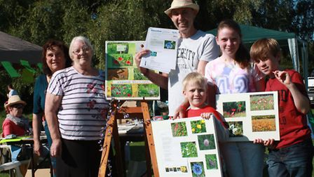 Melbourn Chain of Flowers organisers, Yvonne Chamberlain, and Claire Crossman, with visitors, John a