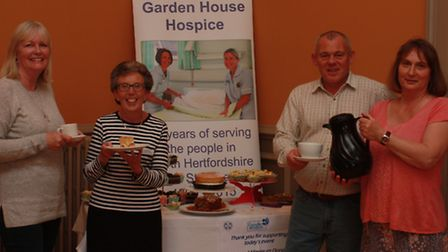 From left to right: Sue Melbourne, community fundraiser, Jo Wiffen, with Bob Spence being offered a