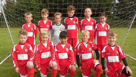 Bluntisham Blasters Under 9s, who play in the Hunts Mini Soccer League, line up in their new kit spo