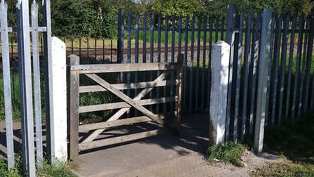 New posts have been cemented in either side of the rail crossing since it has reopened
