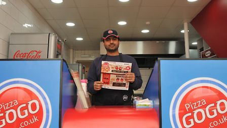 New Pizza Go Go franchisee Khizar Hayat inside the newly refurbished store