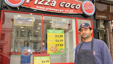 New Pizza Go Go franchisee Khizar Hayat outside the newly refurbished store