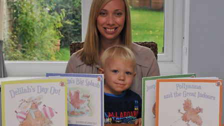Harpenden author Heather Trefusis and her son Leo, 2 with her series of books based on rescued chick