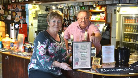 King Of The Belgians owners Bernie and Jim Taylor, with their CAMRA Pub Of The Year award,