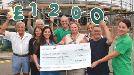 Members of the Broughton Ball Committee, hand over a cheque for £1200, at the Woodlands Centre, Hunt