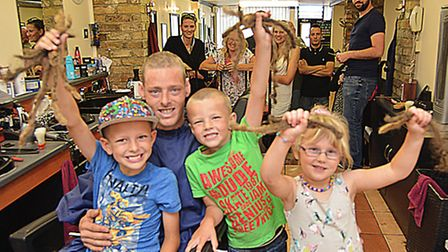Brad King, from Somersham, taking part in Brave The Shave, at Armandos, St Ives, with son's (l-r) Le