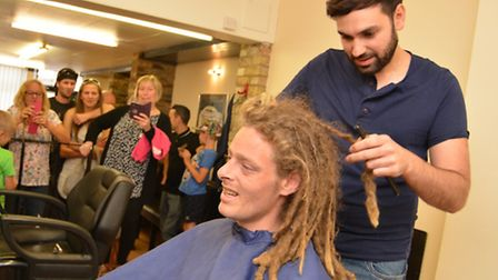 Brad King, from Somersham, taking part in Brave The Shave, at Armandos, St Ives, with barber Fab D'A