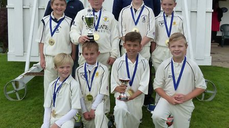 The Ramsey Under 11 team who won the Huntingdonshire Play-Off Final are, back row, left to right, Si