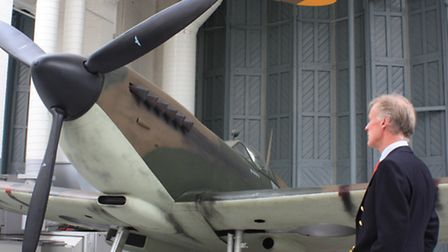 Alan Sinclair, with a Mk.1 Supermarine Spitfire, of the type of aircraft that his father, Gordon wou