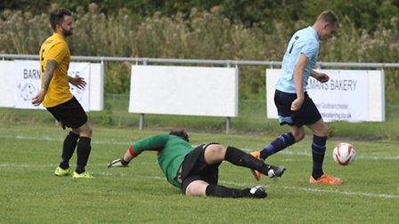 Ben Yeomans (right) hit a hat-trick for Godmanchester Rovers.