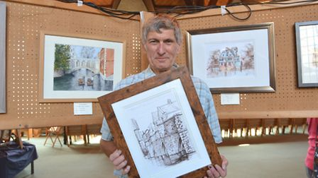 St Ives Art Group exhibition, at th Free Church, Pete Sinfield, with his work,