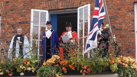 The mayor of Huntingdon, Councillor Bill Hensley, in red, reads the proclamation, with deputy mayor,