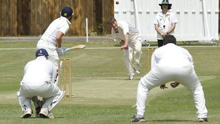 Elliott Baldwin bagged five wickets as Godmanchester moved to the brink of the Tucker Gardner League