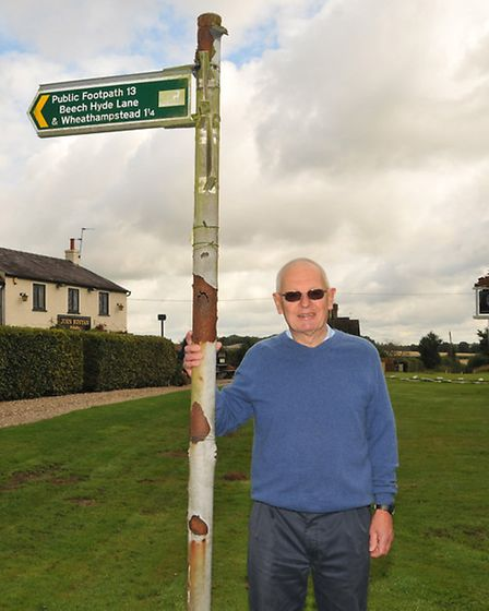 Alderman Chris Oxley outside the John Bunyan pub where an ancient Roman footpath draws walkers from