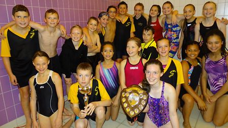 First Strokes Godmanchester swimmers celebrate their success in the Junior Fenland League 'C' Final.