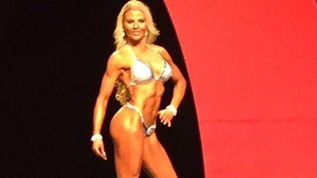 Jennie Bliss, 37, representing the UK on stage in Las Vegas for the Olympia Model Search