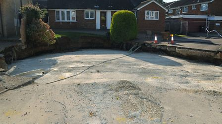 The partially filled in sinkhole on Fontmell Close which has had over 500 cubic metres of foamed con