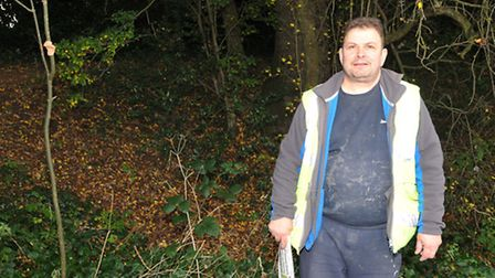 St Albans local Rob Antosik stands in front of the bank of the old clay pit where he used to play as