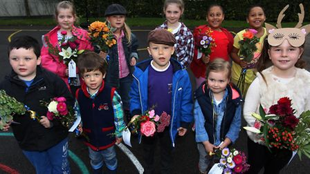 Children from Therfield School with their flowers