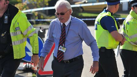 County Councilor Richard Thake speaks to police in the sinkhole cordon