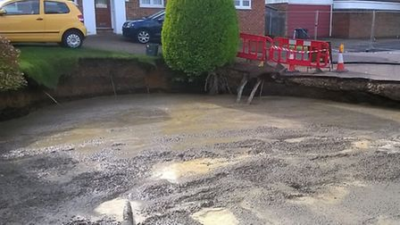 Nearly there: Over 500 cubic metres of foamed concrete have now been poured into the sinkhole in Fon