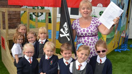 Pupils from Reception class, at Buckden Primary School, celebrate their great Ofsted report, with De