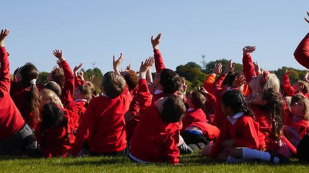 Put your hands up if you're having fun! Children from St Mary's Catholic Primary School. PICTURE: Am