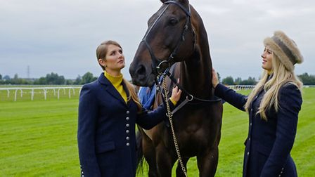 Jockey sisters Gina and Bridget Andrews (pictured, left to right, with former racehorse Niche Market