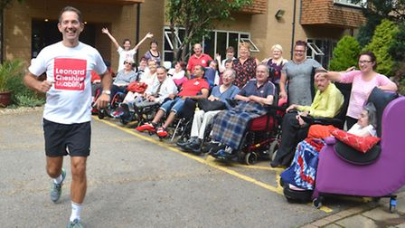 MP Jonathan Djanogly, running for Leonard Cheshire Disability, with some of the residents at Brampto