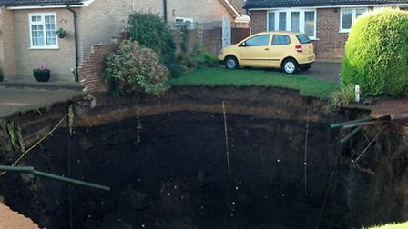 Close-up photos of the sinkhole in Fontmell Close, off the top of Seymore Road in St Albans, which a
