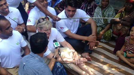 St Albans MP Anne Main is interviewed while visiting Bangladesh