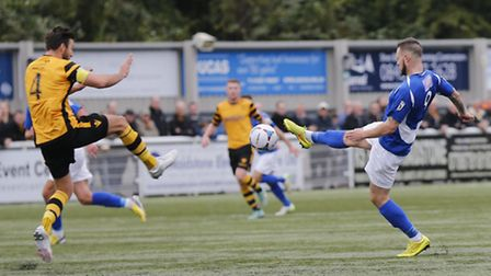 The rubber 'crumbs' are kicked up from the artificial pitch as Louie Theophanous has a shot