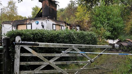 The burnt out thatched cottage on London Road in Well End