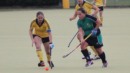 Abby Scarrow (right) of St Ives Ladies in their game against Newmarket.