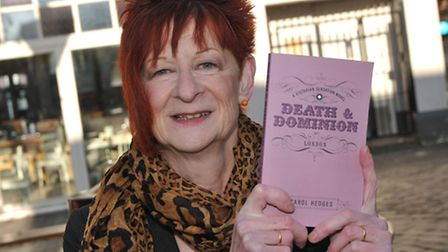 Author Carol Hedges with her latest book, Death and Domination