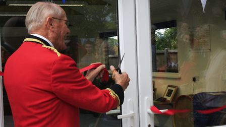 Brian Edwards cuts the tape to officially open the new premises. Clive Porter