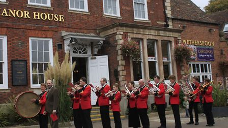 Members of the band marched from The Manor House to their new band room in Tannery Drift. PICTURE: C