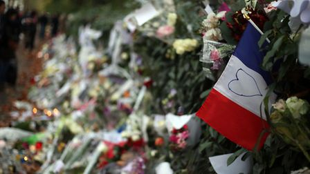 Floral tributes and candles opposite the Bataclan theatre in Paris, after terror attacks killed at l