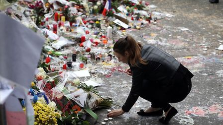 Floral tributes continue to be left near the Bataclan concert hall in Paris following the terrorist