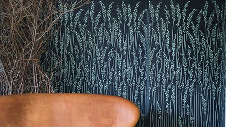 Grass inspired wallpaper on a feature wall