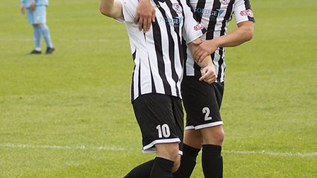 Harry O'Malley (right) scored the goal that took St Ives Town to the top of the league. Picture: LOU
