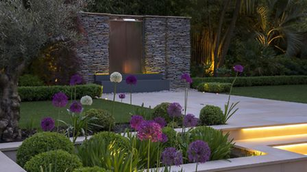 Stone walls and alliums, complimented by Kate Gould light design (copyright Garden Builders)