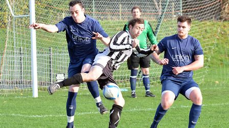 Action from Buckden's derby win over Huntingdon United last Saturday. Picture: HELEN DRAKE