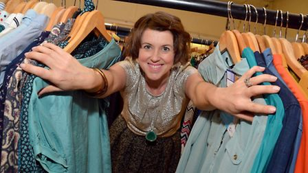 Caroline Jones with her clothes she is selling
